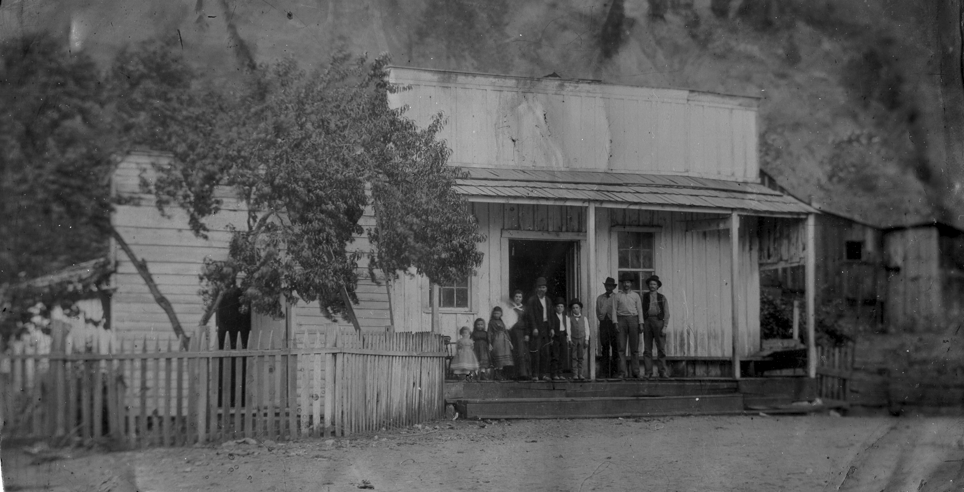 Angelo Rossi family store, Volcano, CA, early 1878. The bundle of white in Maddalena Quirolo Rossi's arms is her infant son, Angelo J. Rossi, future mayor of San Francisco. (from original tintype, courtesy Rose Marie Cleese)